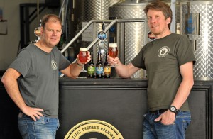 Cam (left) and Scott (owners of the Eight Degrees brewery) challenge you to resist the temptation of their Irish craft beers. Picture by Justin Kernoghan