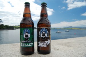 Two bottles of beer from Mountain Man Brewing try to catch some rays before heading down the pub.